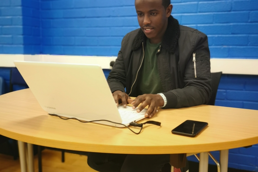 Abdi working on his job applications