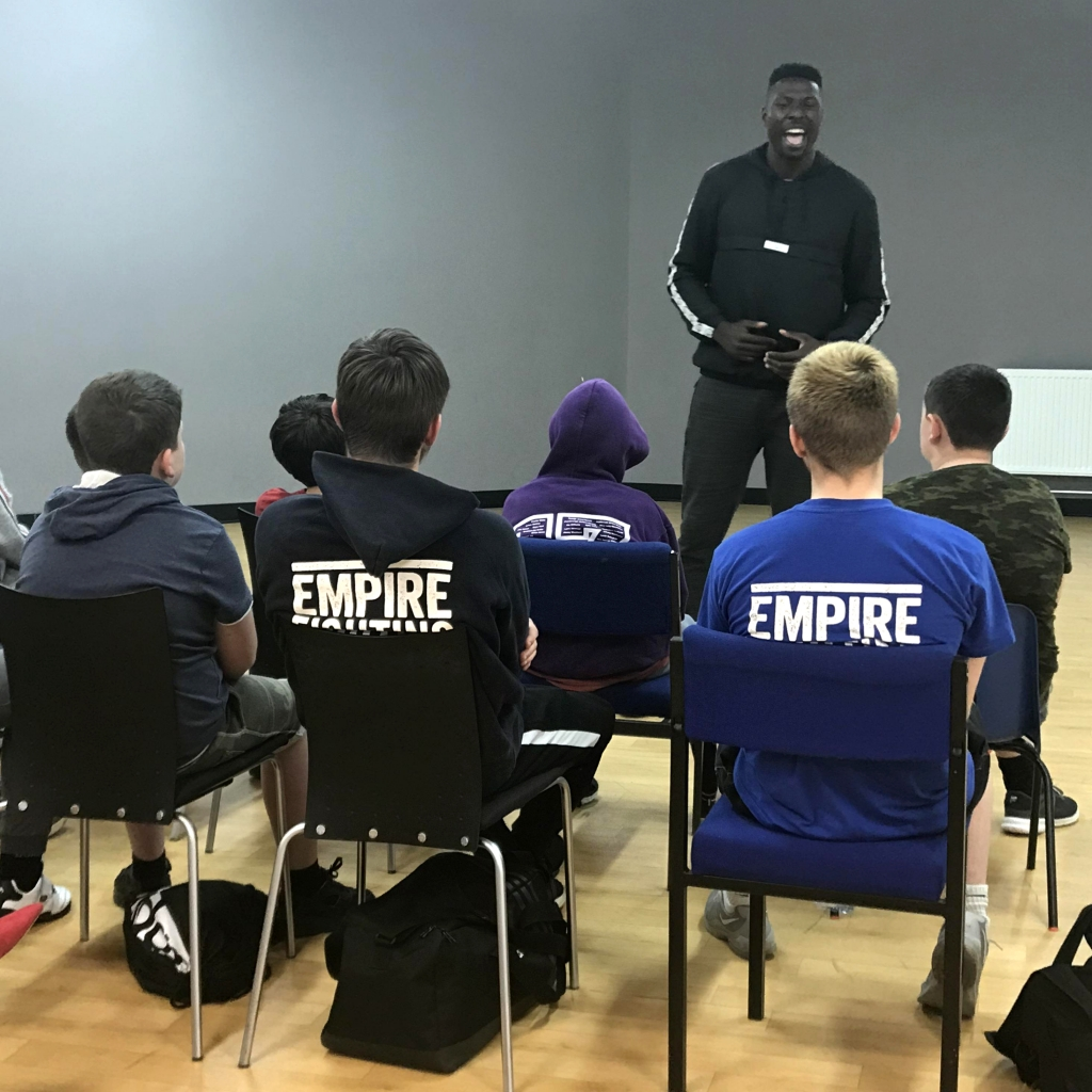 Daniel Edozie of the Bristol Flyers Basketball team talks to a group of young people who go through the Empire Fighting Chance program, about life-skills and resilience which he learnt after being made homeless and later, intercontinental relocation.
